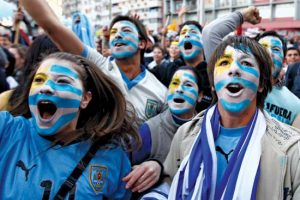 uruguay flag faces of fans