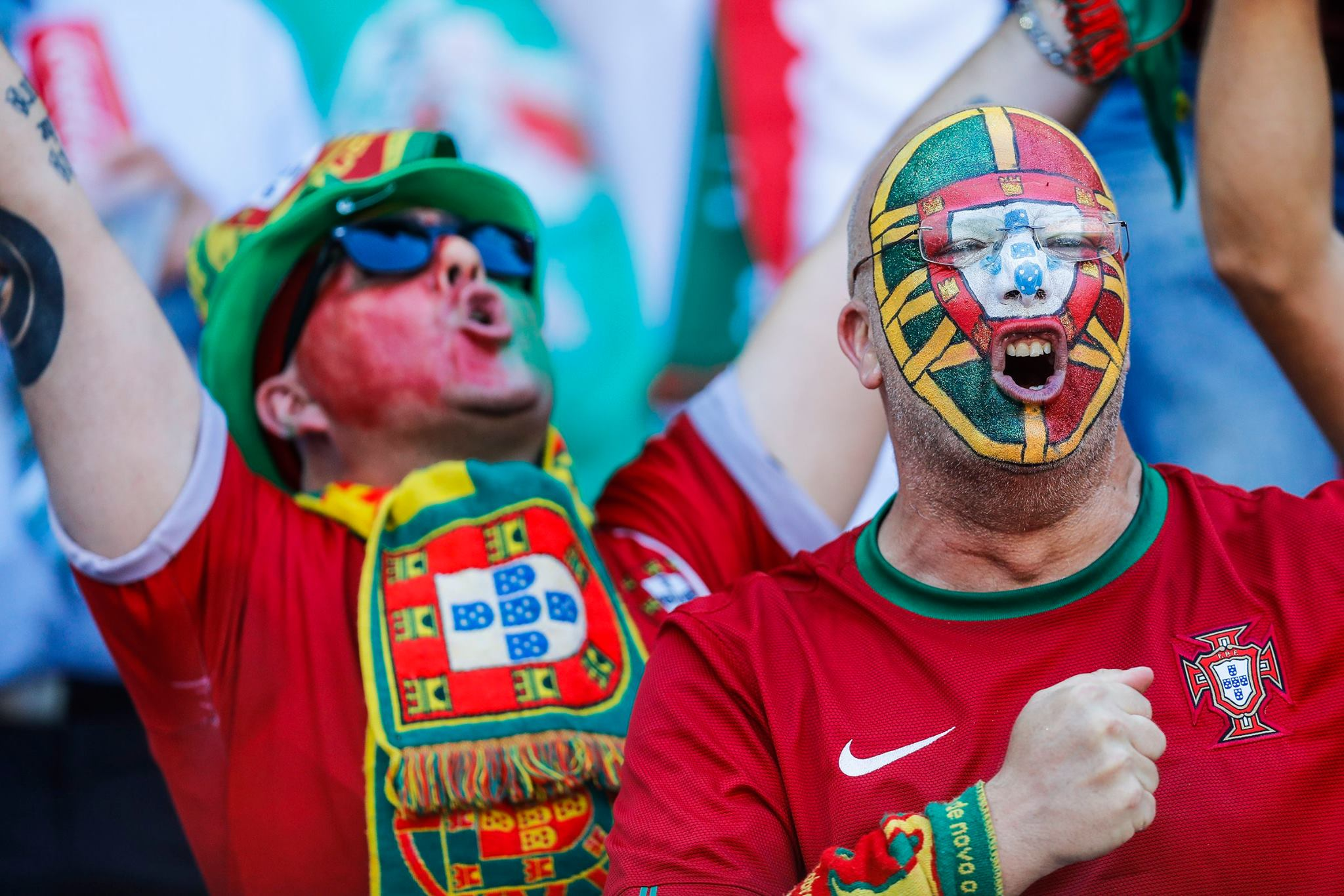 Funny fans faces with portugal flag