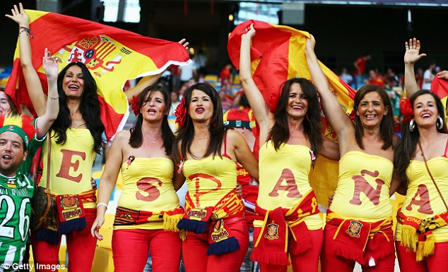 Girls cheer spain with country flag