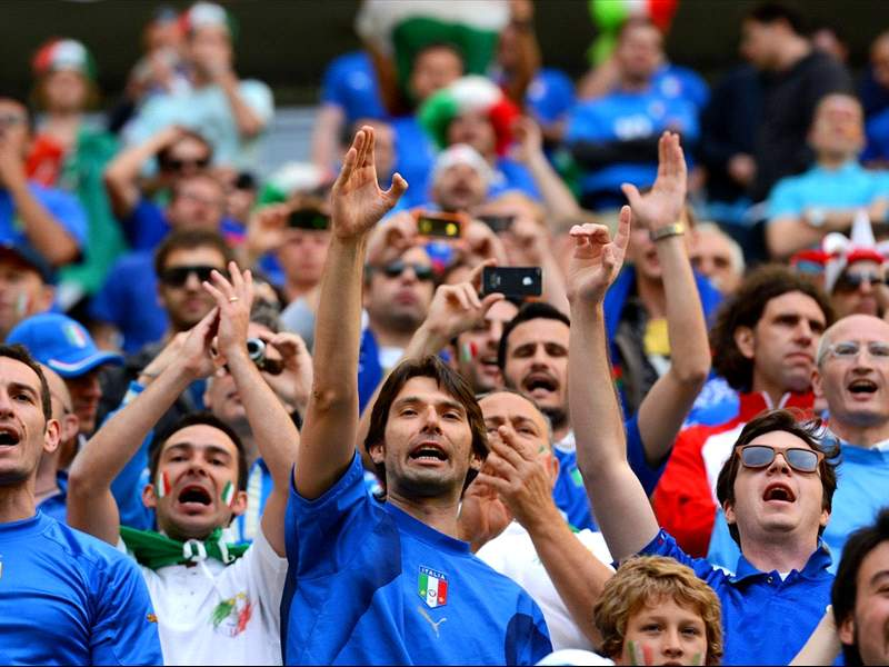 italy fans cheering their country in football game