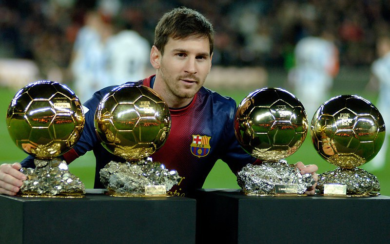 lionel messi with trophy image