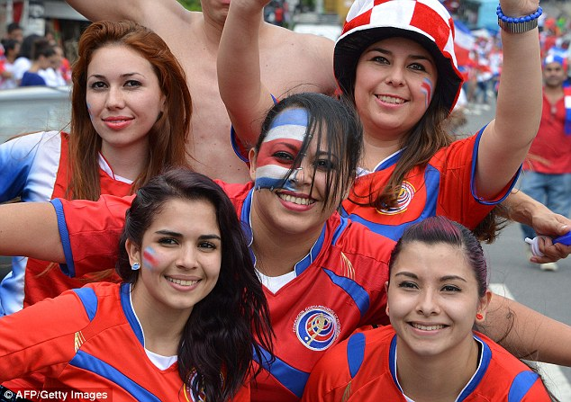 Costa Rica football team fans with nation flag on color on faces