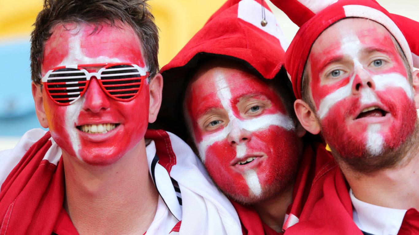 Denmark football team fans with nation flag on color on faces