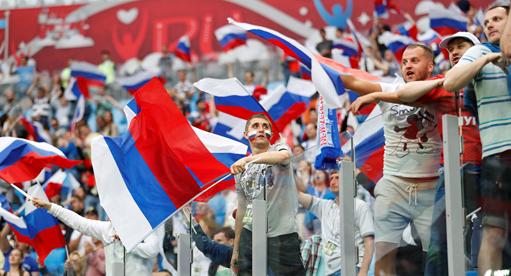 Russia football fans cheer their nation with country flag in world cup tournament