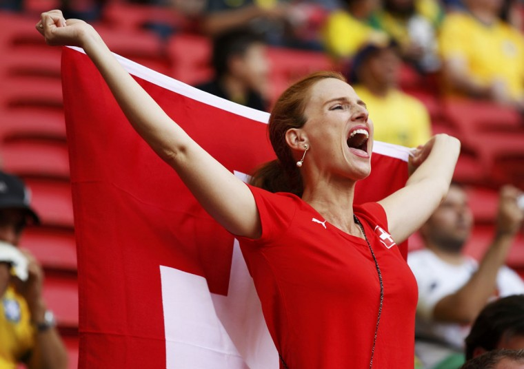 Switzerland girls cheer with their country's flag