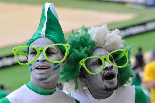 great looking Nigeria soccer fans with country color dress