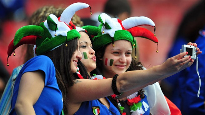 italian girls taking selfie on the football match time