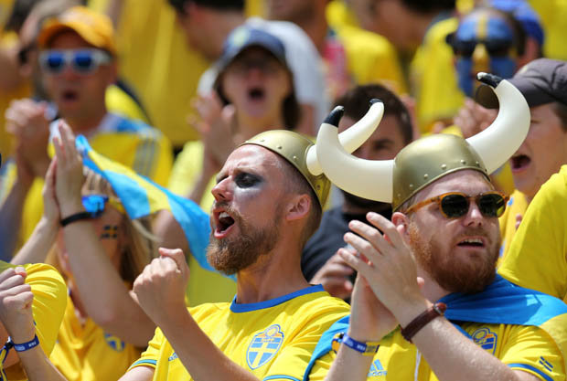 crazy looking Sweden soccer fans